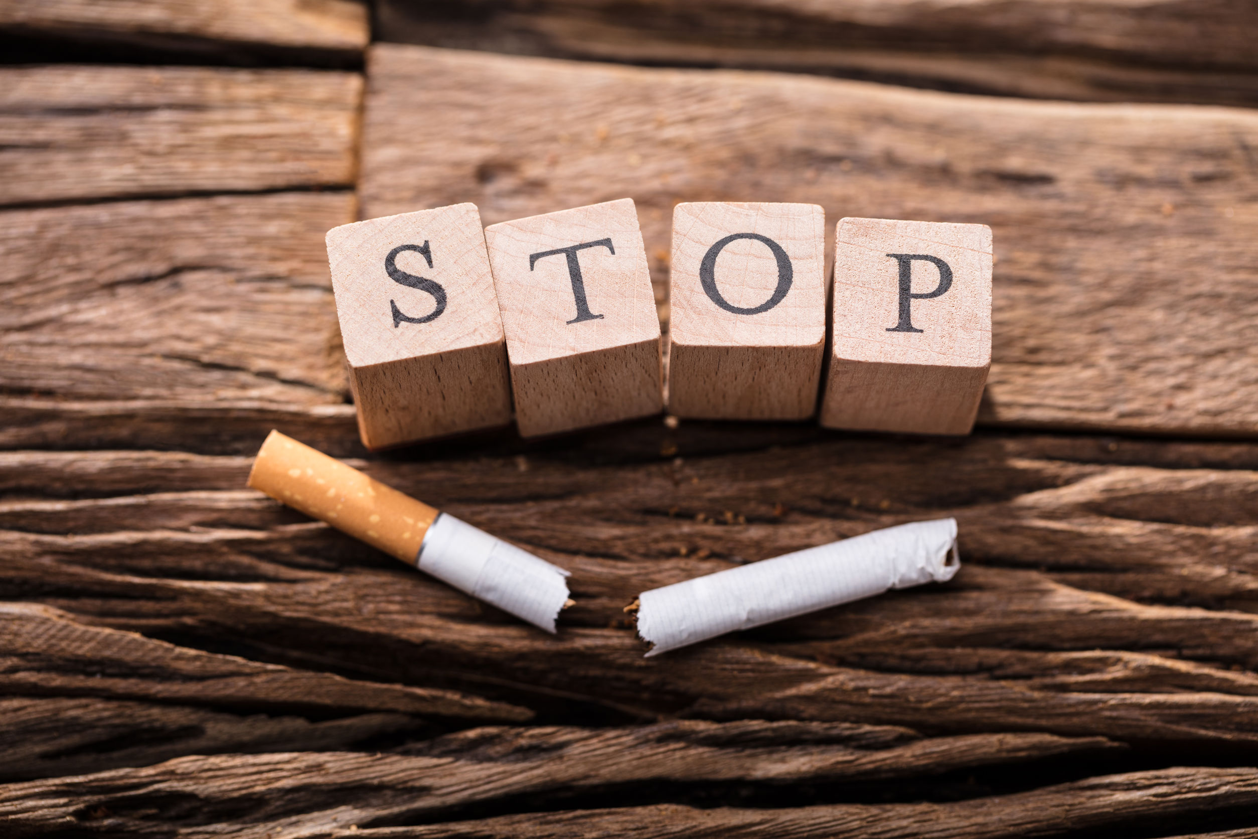 Cigarette And Wooden Blocks Showing Stop Word
